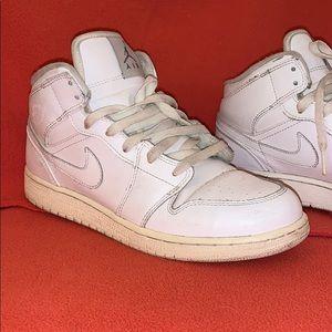 Air Jordon Nike high-tops.